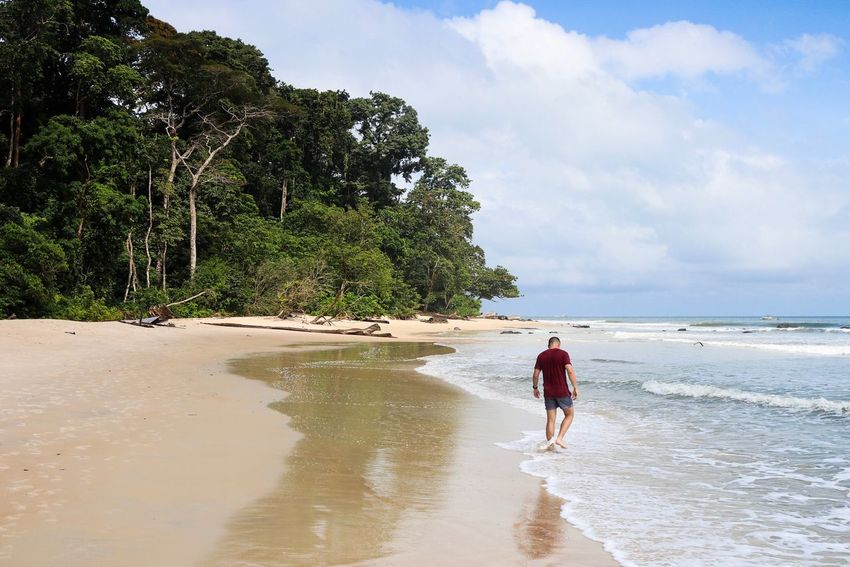 Pointe Denis EyeEm Best Shots Tranquility Africa Gabon Libreville Paradise Water Beach Sky Land Real People Sea Beauty In Nature Cloud - Sky Tree Full Length One Person Leisure Activity Plant Nature Lifestyles Day Scenics - Nature Sand Outdoors Horizon Over Water