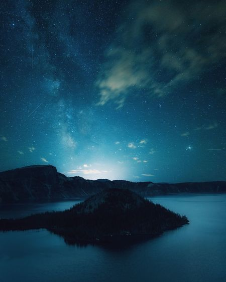 Crater Lake. Star - Space Astronomy Space Night Scenics - Nature Galaxy Summer Road Tripping Star Nature Milky Way Sky Tranquil Scene Tranquility Beauty In Nature Science Blue Star Field Water Space And Astronomy Silhouette No People HUAWEI Photo Award: After Dark