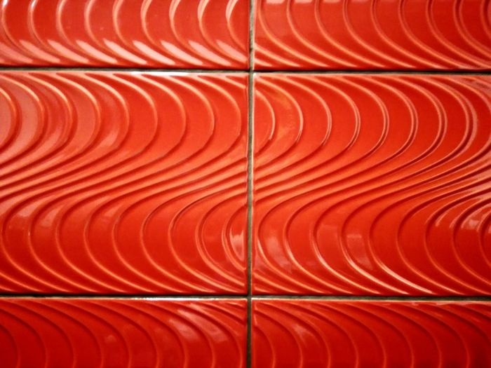 Full frame shot of red patterned metallic wall