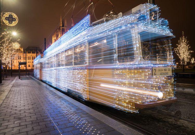 Illuminated Tram At Night