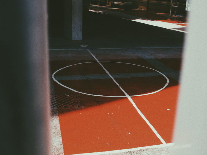 Close-up of basketball hoop against wall