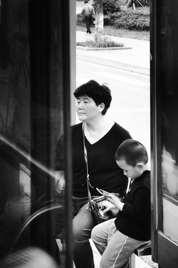 surface of Suchoow No. 2, more and more help their son and daughter take care of their children. Waiting For The Bus PhonePhotography Streetphotography Phone Photography Street Photography Black & White Black And White Photography Black And White Street Photography Grandma Young Women Child Musician Sitting Looking Through Window Standing Window Fretboard Plucking An Instrument Musical Instrument String Gramophone