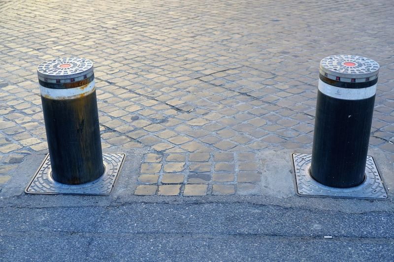 Rising bollards prevent traffic from entering an area Caution Entrance Forbidden Poller Traffic Access Alert Barrier Bollard Bollards Control Limit No People Outdoors Prevent Restricted Restriction Roadway Stop Urban Warning