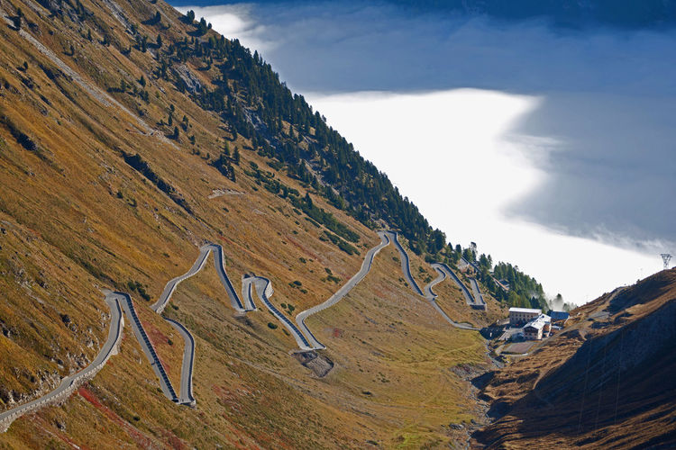 Curved Road On Mountain Against Sky