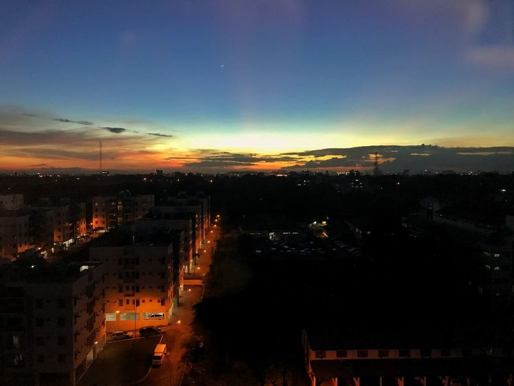 After work view EyeEmNewHere Jagred Street Lights Building Exterior Architecture City Sky Built Structure Cityscape Cloud - Sky Sunset High Angle View Building Residential District Orange Color City Life