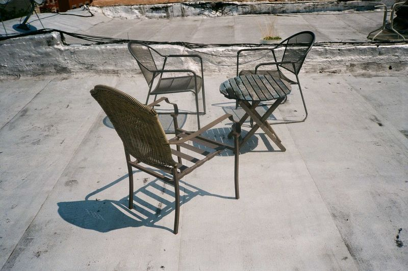 High angle view of empty chair on table during winter