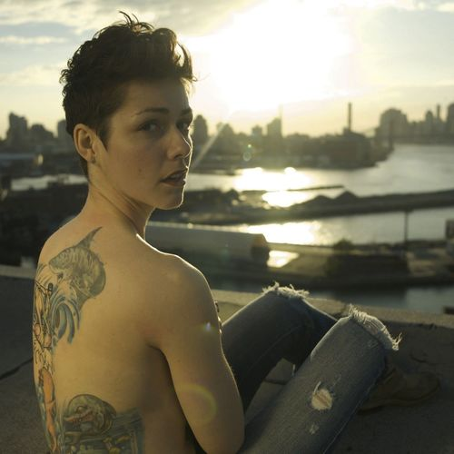 One Person Water Young Adult Real People Leisure Activity Lifestyles Adventures In The City Sunlight Nature Focus On Foreground Looking Away Tattoo Day Sunset Sky Beautiful Woman Portrait Outdoors Young Women Women Shirtless Visual Creativity