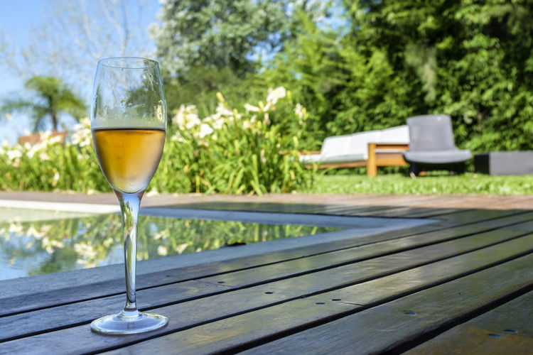 Close-Up Of Champagne On Poolside