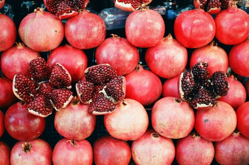 Close-up of pomegranates for sale at market stall