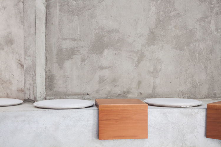 View of wooden table against wall at home