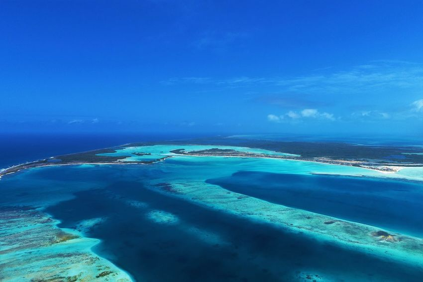 Aerial view of island and beach in Los Roques, Venezuela Water Blue Scenics - Nature Sky Sea Nature Beauty In Nature Cloud - Sky No People Tranquility Tranquil Scene Outdoors Land Idyllic Aerial View Travel Day Travel Destinations Island Lagoon Turquoise Colored Los Roques Madrisqui Caribe Caribbean Caribbean Life Caribbean Island Francisqui Crasqui Carenero's Beach Cayo De Agua Venezuela