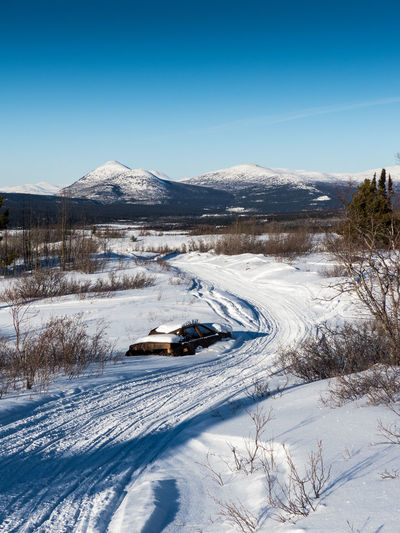 wrong turn Beauty In Nature Blue Canada Carwreck Clear Sky Cold Temperature Day Hulk Landscape Landscape_Collection Landscape_photography Mountain Mountain Range Nature No People Outdoors Scenics Sky Snow Tranquil Scene Tranquility Wilderness Winter Yukon