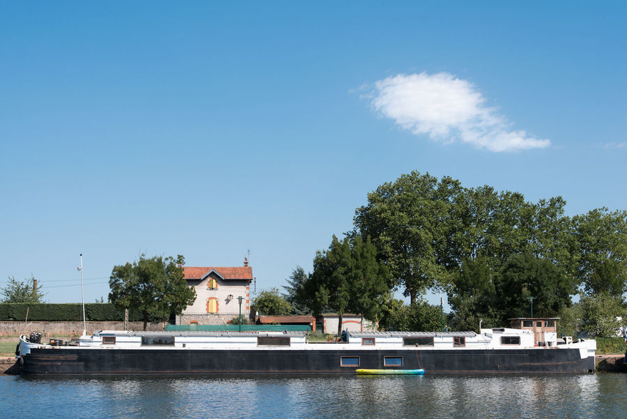 Barge Home Architecture Boat Building Exterior Built Structure Cloud - Sky Clouds And Sky Day House House Boat Landscape Nature Nautical Vessel No People Old Outdoors River Sky Tree Vintage Water