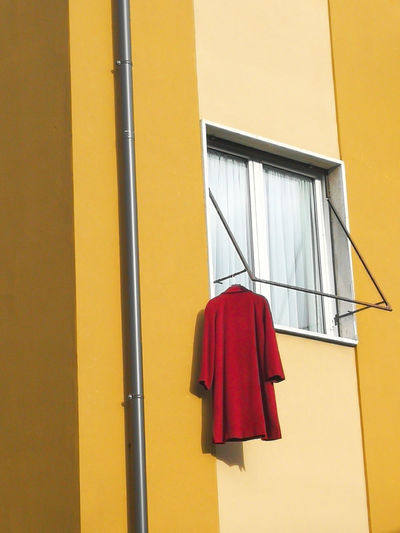 Red coat Coathanger Drying Hanging Yellow Window Red Retail  Architecture Building Exterior Built Structure