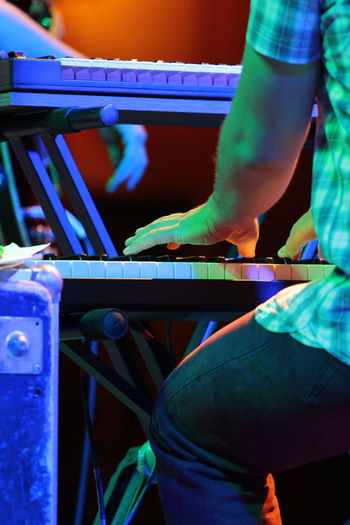 Cropped Image Of Man Playing Piano At Concert