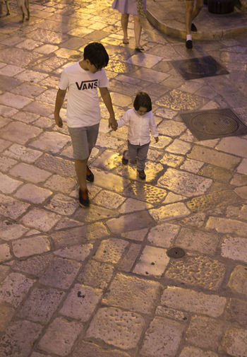 Birdview Brother & Sister Brotherhood Casual Clothing Child Childhood Children People Real People Shadow Street Streetphotography Togetherness Two People Walking