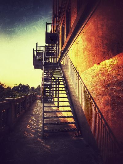 Staircase by building against sky