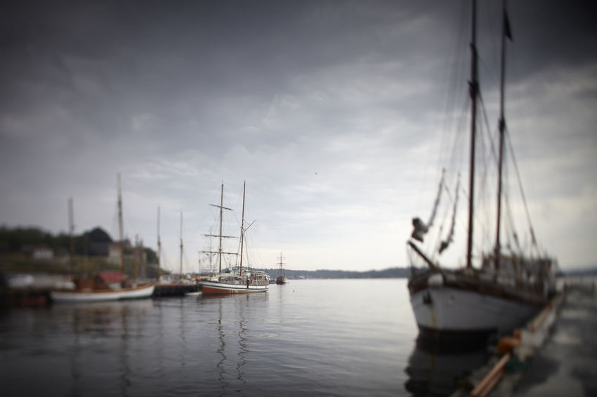 Boats on Oslo Harbor Beauty In Nature Cloud - Sky Day Dramatic Sky Harbor Mast Mode Of Transport Nature Nautical Vessel No People Nordic Norway Oslo Outdoors Rigging Sailboat Sailing Ship Scandinavia Scandinavian Sea Sky Tall Ship Transportation Vignette Water