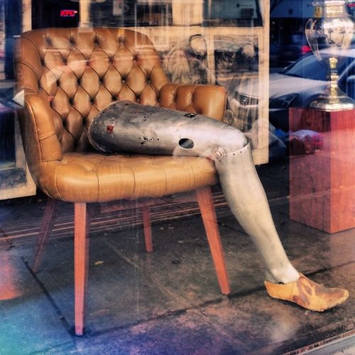 Reflection NYC Streetphotography Vintage Leg Brooklyn Colorphotography Antiquestore FujiX100S Prosthetic Prostheticleg Vintageprosthetic Leatherchair Vintagechair Vintagestore