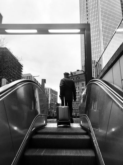 Man on a mission Blackandwhite Frankfurt Escalator Architecture Built Structure Real People Railing Escalator Staircase Steps And Staircases Full Length Transportation One Person Building Exterior Men Lifestyles Low Angle View City Modern Walking Steps