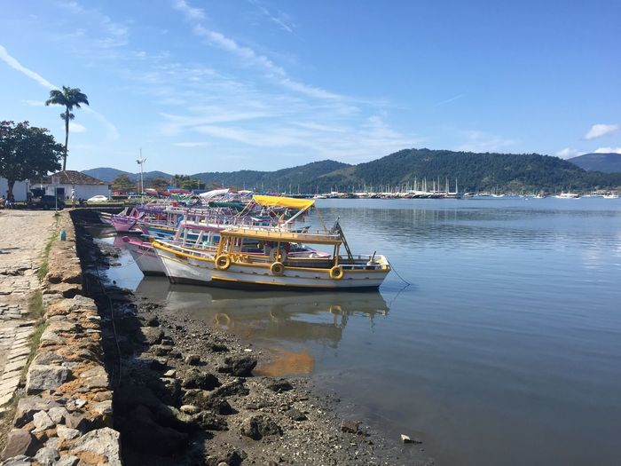 Low Tide Colorful Boats Mode Of Transport Water Nautical Vessel Transportation Moored Sky Outdoors Day Nature Sea Mountain Beauty In Nature No People