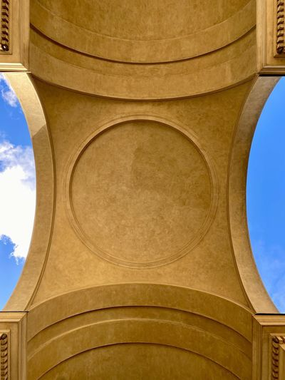 Low angle view of ornate ceiling against sky