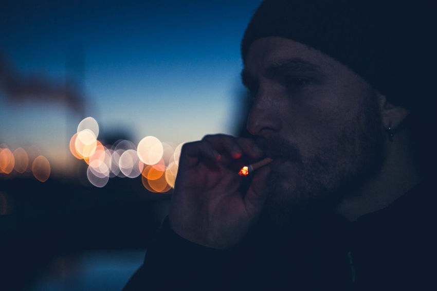 Bokeh Dusk Dusk In The City Igniting Illuminated Light Effect Night One Man Only One Person Smoking Twilight