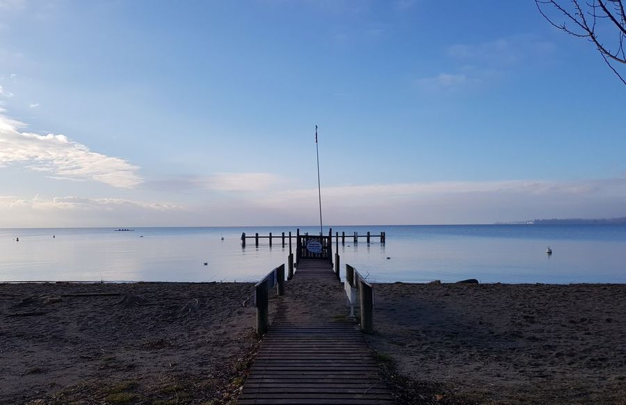 Sea Beach Water Sky Sand Horizon Over Water Pier Tranquility Cloud - Sky Blue Tranquil Scene Beauty In Nature Nature Sun No People Vacations Outdoors Travel Destinations Day