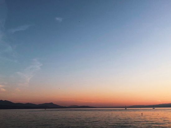 Switzerland EyeEm Best Shots EyeEmNewHere Lac Léman Lausanne Saint Sulpice Sky Water Scenics - Nature Beauty In Nature Sunset Tranquil Scene Tranquility Sea Nature Idyllic Mountain No People Cloud - Sky Waterfront Beach Non-urban Scene Land Outdoors Orange Color