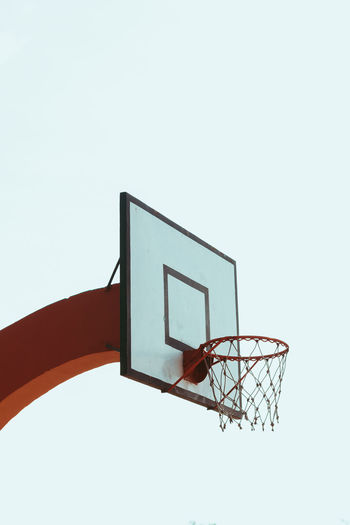 Low angle view of basketball hoop against sky