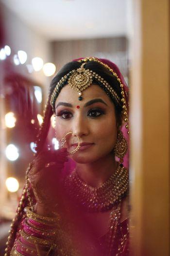 Bride looking at mirror during wedding ceremony