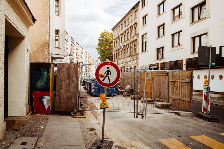 Humans forbidden! Berlin Mitte Berlin Photography City City Street Construction Forbidden Urban Geometry Berliner Ansichten Built Structure City City View  Communication Day Daylight No People Residential Building Residential District Road Road Marking Road Sign Sign Street Streetphotography Urban Warning Sign