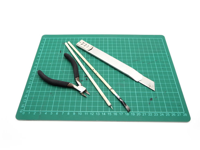Tools with green cutting mat for model kit isolated on white background. Business Copy Space Cut Out Diagram Directly Above Education Equipment Green Color Hand Tool High Angle View Indoors  No People Paper Shape Still Life Studio Shot Tool White Background Work Tool