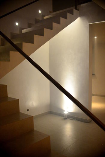 EyeEm Best Shots Eye4photography  Getting Inspired Staircase Architecture Steps And Staircases Indoors  Illuminated Railing Built Structure Lighting Equipment No People Empty Wall - Building Feature Flooring Building Home Interior Absence Wall Entrance Entrance Hall Ceiling Light And Shadow Lighting Equipment