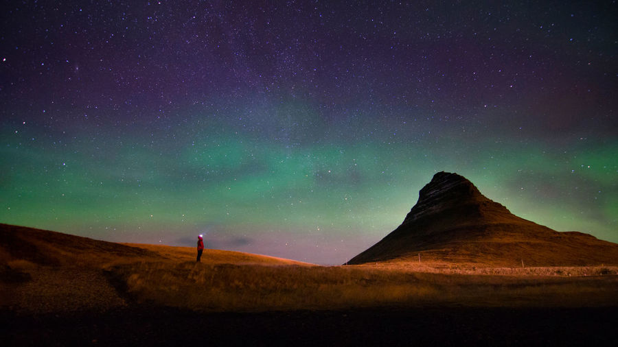 Scenic View Of Aurora Borealis Above Kirkjufell Mountain