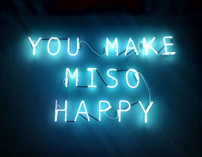 Low angle view of neon message on wall