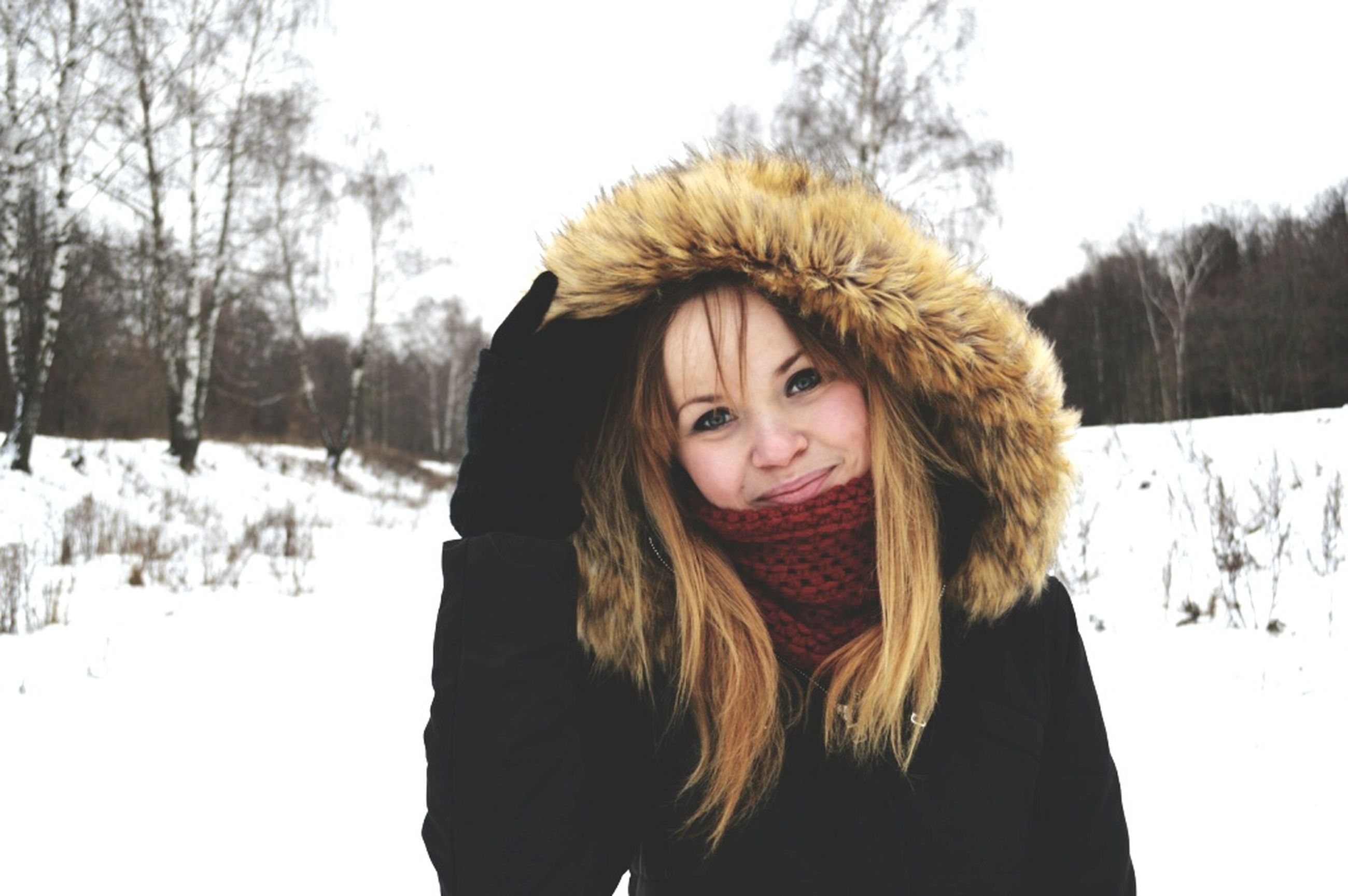 winter, portrait, snow, cold temperature, looking at camera, young adult, front view, lifestyles, person, season, young women, warm clothing, tree, leisure activity, smiling, clear sky, casual clothing, headshot