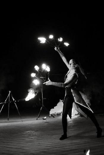 Full length of man photographing illuminated at night