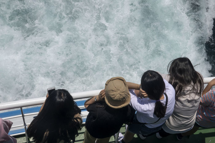 On board to Udo Island in Jeju Island, South Korea JEJU ISLAND  Passenger Adult Childhood Day Friendship Girls Nature On Board On Boat Outdoors People Real People Sea Sitting Standing Togetherness Traveller Udo Voyage Water Wave Women