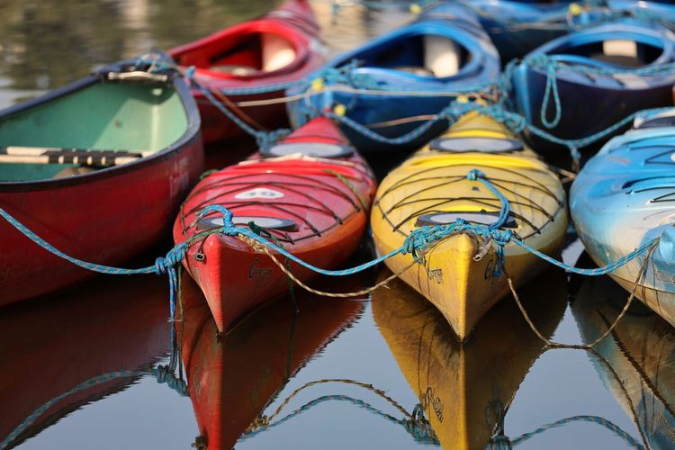 Close-up of boats moored in lake