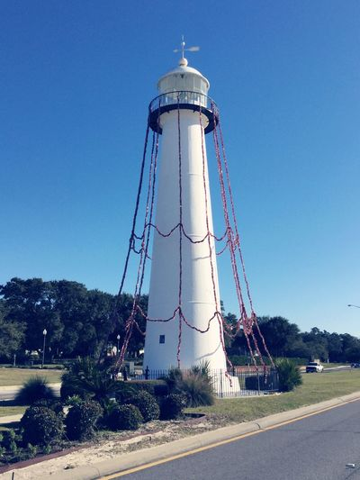 biloxi lighthouse during the day Biloxi Mississippi  Lighthouse Built Structure Blue Sky Day No People Architecture Building Exterior
