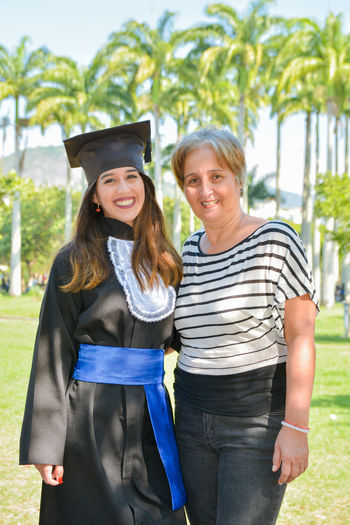 Mama 💜 Enjoyment Manager Administrator Administration Friendship Young Women Portrait Togetherness Smiling Happiness Women Females Looking At Camera Cheerful Mortarboard Arm In Arm University Adult Student Certificate University Student Hugging