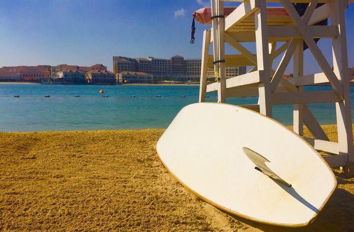 Surfboard on beach in Abu Dhabi Surf Surfing Board Beach Beachphotography Sea lifeguard Abu Dhabi UAE Shangrilahotel Shangrila