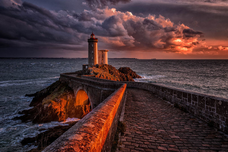 Night is coming Architecture Beauty In Nature Cloud - Sky Coastline Dramatic Sky Dusk Horizon Over Water Landscape Lighthouse Lighthouse No People Outdoors Romantic Sky Scenics Sea Sky Sunset Travel Destinations