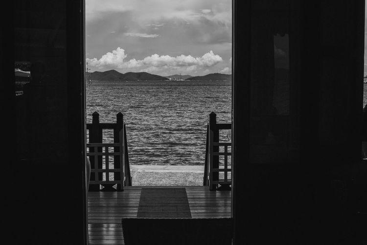 Scenic view of sea seen through open door