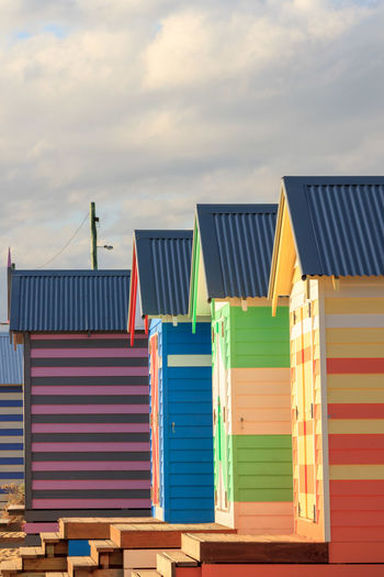 Low Angle View Of Multi Colored Beach Huts Against Sky