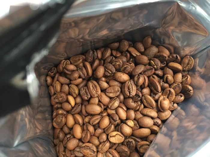 Close-up of roasted coffee beans in bag