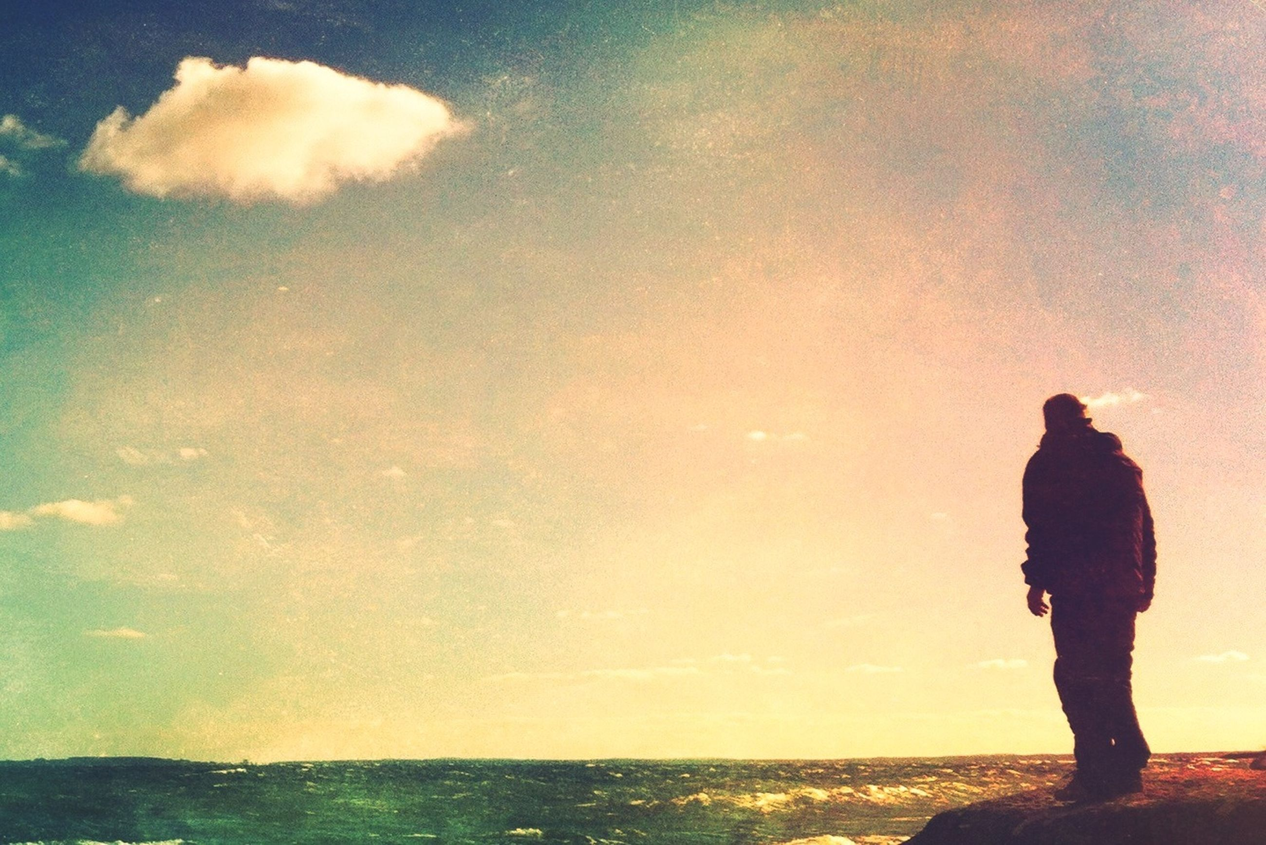 sea, horizon over water, water, sky, silhouette, standing, leisure activity, lifestyles, tranquil scene, tranquility, beach, scenics, beauty in nature, rear view, shore, nature, sunset, full length