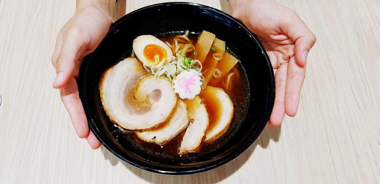 The big ramen noodle is on my hand Holding Hand Service Hot Full BIG Carrying Ramen Noodle Black Bowl Soup Sliced Pork Boiled Egg Human Hand Directly Above Egg Yolk Table High Angle View Close-up Sweet Food Food And Drink Served Serving Size Ready-to-eat Noodles Japanese Food Ramen Noodles