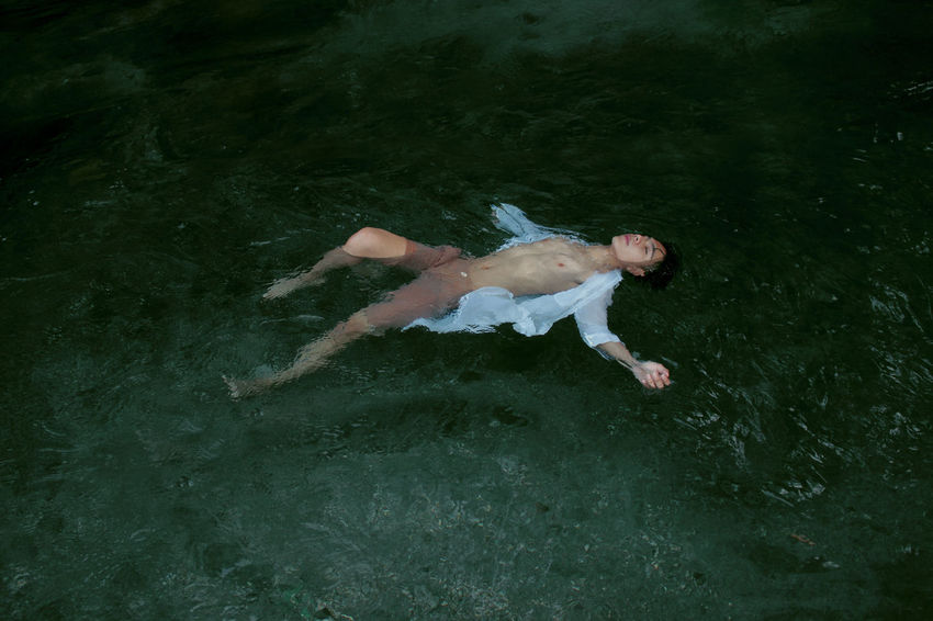 Affliction Affliction Day Floating On Water Flows Forest Human Body Part Male One Person Outdoors People Portrait Water